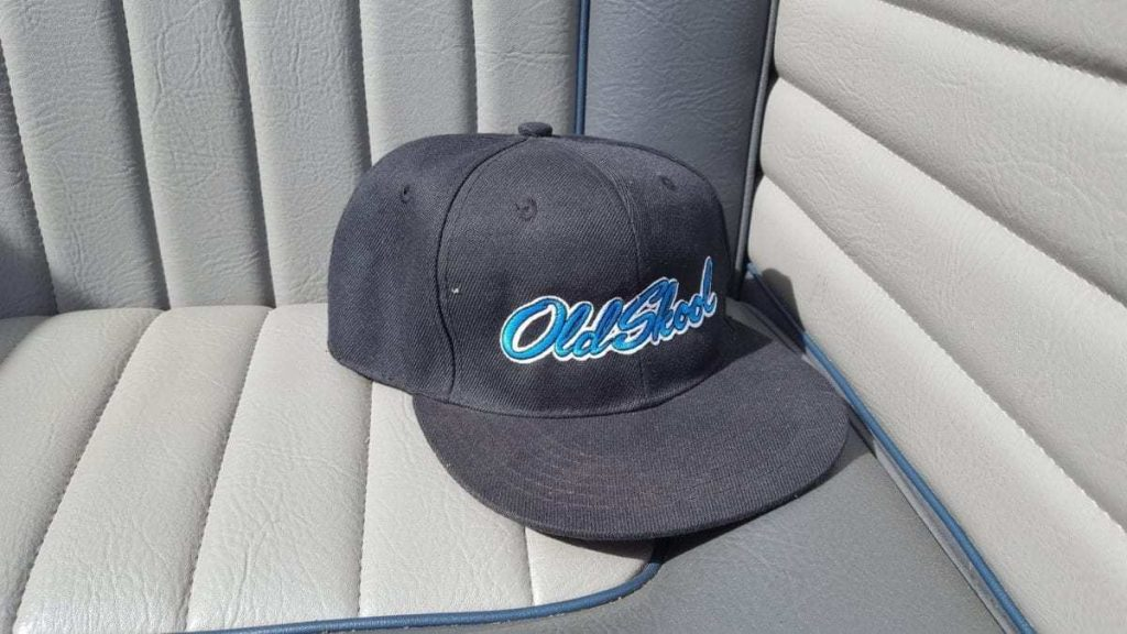 Ball cap with Old Skool embroidered sitting on a custom classic Volkswagen Window Vab